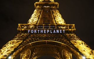 "The slogan ""FOR THE PLANET"" is projected on the Eiffel Tower as part of the COP21, United Nations Climate Change Conference in Paris, France, Friday, Dec. 11, 2015. (AP Photo/Francois Mori)"